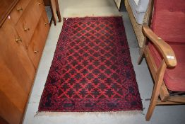 A traditional Afghan style rug, red ground, approx. 147 x 88cm