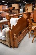 A modern pine bed frame , overall width 165cm, (150cm mattress width)