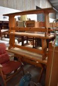 A pine kitchen table and two bench seats