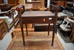 An early 20th Century mahogany framed piano stool, no seat, good upholstery project