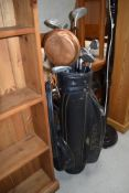 A selection of golf clubs including King Cobra and Daiwa, with bag and balls