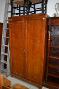 An early 20th Century mahogany wardrobe having semi fitted interior, approx. 108cm width including