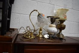 A selection of lamps, electric and oil type