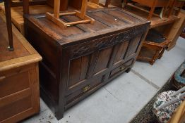 A period oak four panelled kist/coffer , carved frieze bearing date 1799, monogram MB, two drawers