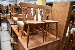 A pair of traditional solid seat kitchen chairs