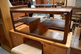 A vintage G plan or Danish teak coffee table , interesting design with undershelves and magazine