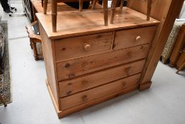 A natural pine chest of two over three drawers