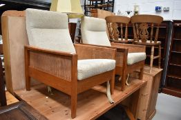 A pair of 1970s lounge chairs , frames possibly elm, canework sides