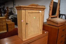 A natural pine bathroom or similar wall cabinet