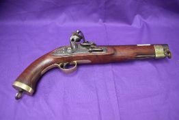 A 19th century flintlock pistol, brass mounts, swivel ram rods, lock marked Manton, lock plate