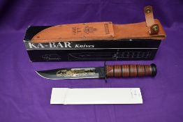 A Ka-Bar Knife, US Army Pearl Harbour 60th Anniversary, with leather scabbard, overall length