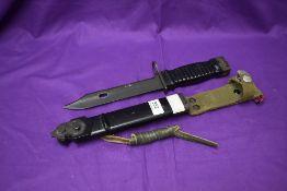 A German 1963 Stoner Assault Rifle Bayonet, blade marked Carl Eickhorn & Co Solingen, metal