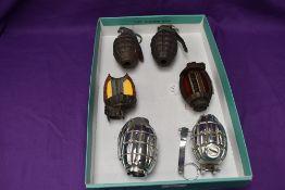 Two British Inert Hand Grenades, two British Inert Chromed Hand Grenades and two cut out sections