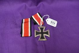 A German 1939 Iron Cross with ribbon and a spare ribbon