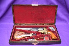 A Blank Firing Replica Colt Navy Revolver (af) in fitted wooden case with decorative copper Powder