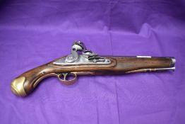 A 19th century flintlock pistol, brass mounts, ram rod, lock plate stamped Tower, Crown with GR