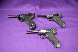 A reproduction Luger 1720 P-08 Parabfllum Pistol and two reproduction Luger Pistol with no moving