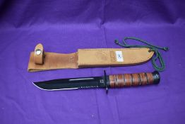 A USMC MFH Fighting Knife with leather scabbard, overall length 31cm