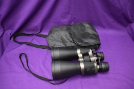 A pair of Traveler 10-30 x 60 Binoculars, all caps present, in soft carry case