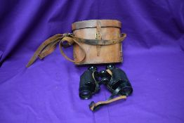 A pair of World War Two Air Ministry binoculars, by Wray of London, numbered 6E/293 above AM
