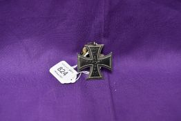 A German 1813-1914 Iron Cross with ribbon