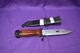 A Russian Bayonet for the AK Series of Rifles, plastic grip, wire cutter scabbard, blade length