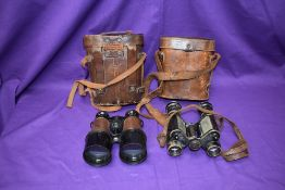 A pair of early 20thC French military issue binoculars bearing serial number 289360 and with gauge