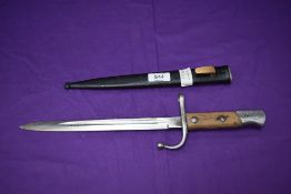 A Turkish Mauser Model 1903 Short Bayonet with metal scabbard, Turkish marks on crossguard and