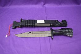 A 1985 British Knife Bayonet L3A1 for a SA80 Rifle with scabbard, scabbard contains saw blade and