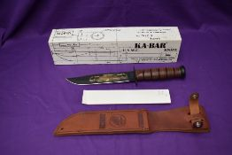 A Ka-Bar Knife, Pearl Harbour 60th Anniversary, with leather scabbard, overall length 31cm, in
