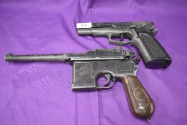 A Umarex reproduction Browning Model GPDA8 Pistol and a reproduction Waffenfabrik Mauser Pistol