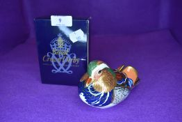 A Royal Crown Derby mandarin duck having silver stopper,with box.