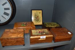 A collection of vintage jewellery boxes, some hand painted and another with inlaid scene.