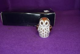 A Royal Crown Derby Owlet paper weight having gold stopper,with box.