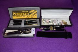 A collection of ball point pens including Platignum.