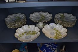 A collection of French ceramics having scalloped edges,gilt accents and Hydrangea design to cream