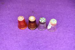 A selection of four fine and detailed miniature glass makers thimbles having various designs