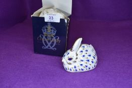 A Royal Crown Derby rabbit having silver stopper,with box.