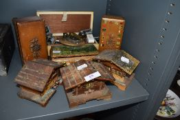 A collection of vintage trinket and jewellery boxes,some musical,others in the form of cottages also