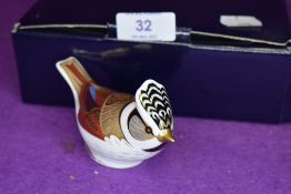 A Royal Crown Derby goldcrest paper weight having gold stopper,with box.