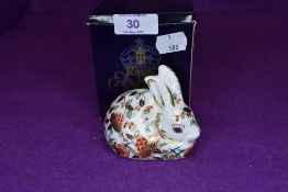 A Royal Crown Derby meadow rabbit paper weight having gold stopper,with box.