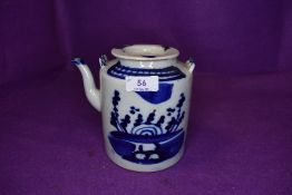 A Chinese export hard paste tea pot with blue and white decoration