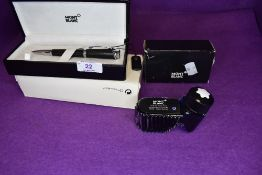 A Montblanc ballpoint pen in original case. Black with diamond pattern to the band and Amethyst in