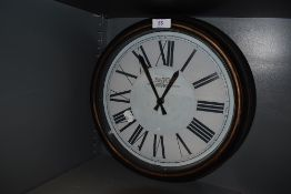 A vintage station style wall clock.