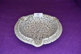 A crackle glazed German pottery ashtray.