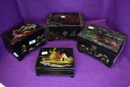 Four vintage music boxes with inlaid,hand painted details and carved details.