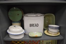 A variety of vintage enamel kitchenalia including bread bin,cake tin and more.