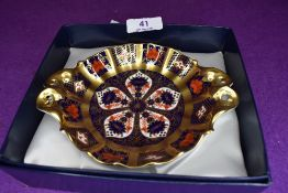 A Royal Crown Derby pin or trinket dish on red back stamp with box.