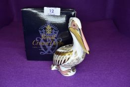 A Royal Crown Derby pelican having gold stopper,with box.