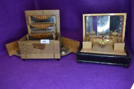 Two vintage cigarette boxes, one having inlaid detailing,integrated ashtrays and later additions